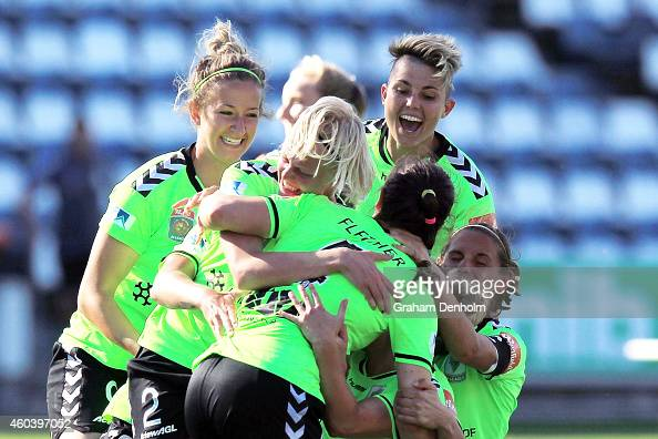 Canberra United celebrate victory in the WLeague Semi Final match between Melbourne Victory and Canberra United at Simonds Stadium on December 13...