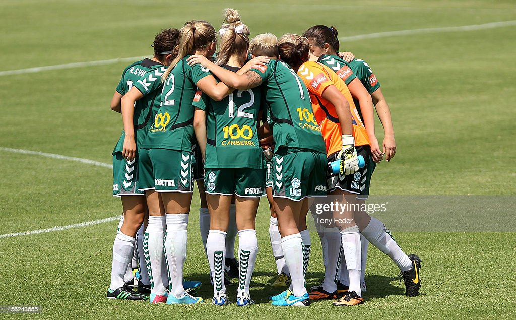 Canberra United huddle pre-game during the round five W-League match between the Newcastle Jets and Canberra United at Wanderers Oval on December 14, 2013 in Newcastle, Australia.