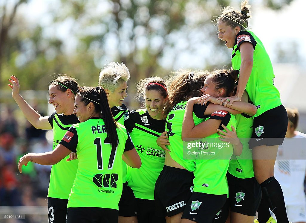 Canberra United players celebrate after Jenna McCormick of Canberra United scored a goal during the round nine WLeague match between Canberra United...