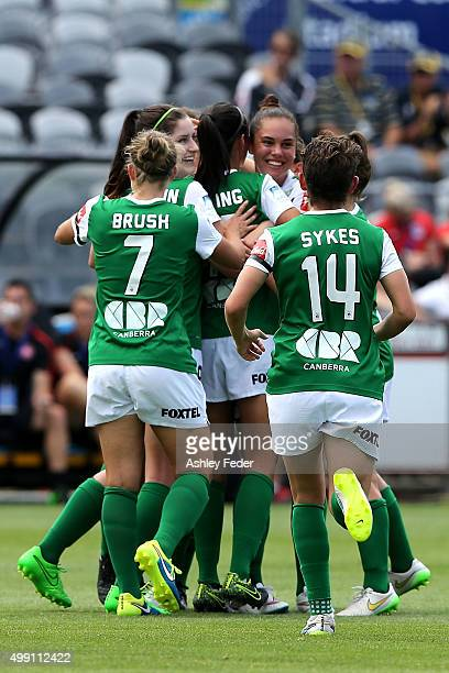 Canberra United team mates celebrate a goal during the round seven ALeague match between the Western Sydney Wanderers and Canberra United at Central...
