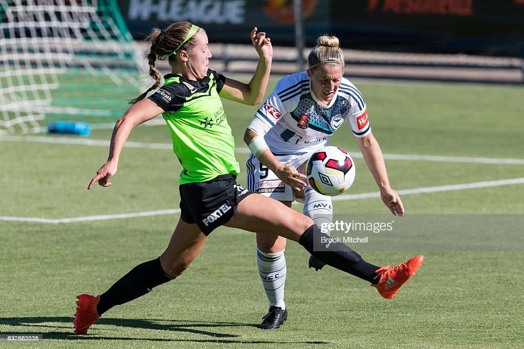 Canberra United's Celeste Boureille grapples with Melbourne Victory's Natasha Dowie during the round 14 W-League match between Canberra United and Melbourne Victory at McKellar Park on January 28, 2017 in Canberra, Australia.