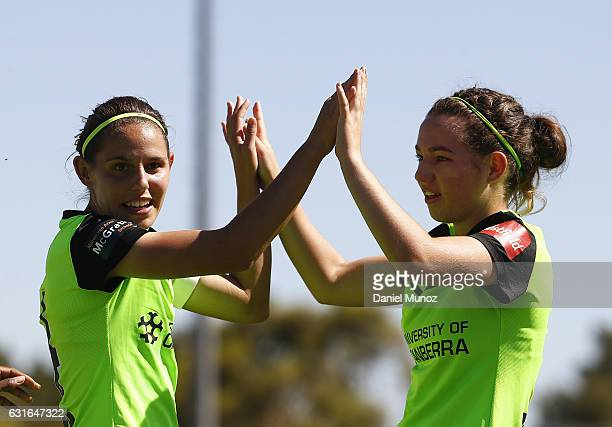 Canberra's Ashleigh Sykes celebrates after scoring with Grace Maher during the round 12 WLeague match between Canberra United and the Perth Glory at...