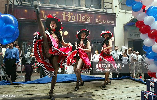 Cancan dancers perform during the Brasserie Les Halles Bastille Races and Liberty Festival July 14 2004 in New York City The 11day celebration in the...