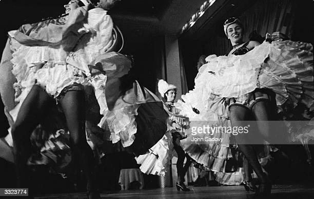 CanCan girl Regine performing with the rest of the troupe at the Moulin Rouge in Paris