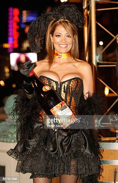 Cancan models Kimberly Battistini holds a bottle of 2008 Georges Duboeuf Beaujolais Nouveau wine at the Paris Las Vegas early November 20 2008 in Las...