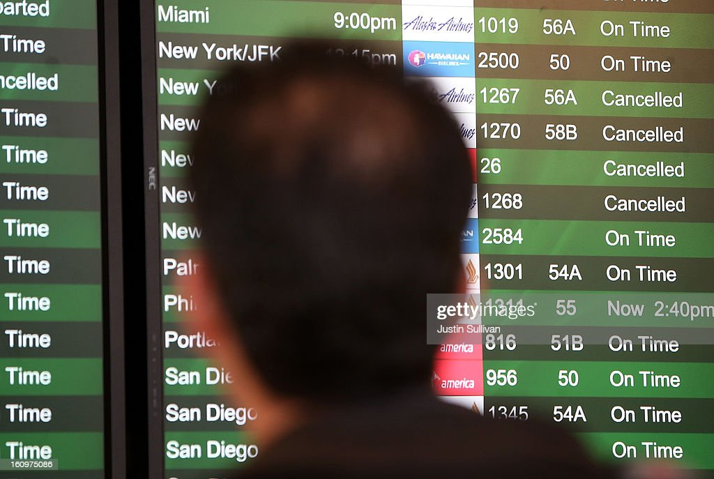 Canceled flights due to weather are displayed on a departure monitor at San Francisco International Airport on February 8, 2013 in San Francisco, California. Thousands of flights to the East Coast were canceled as a potentially historic blizzard is set to dump up to three feet of snow in the Northeast from New York City to Boston.