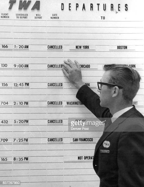 JUL 8 1966 'Canceled' Signs Tell Airline Story P R de I'Etoile ticket agent at Trans World Airlines posts notices at Denver's Stapleton International...