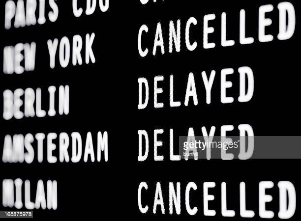 Cancelled and delayed flights on a airport screen