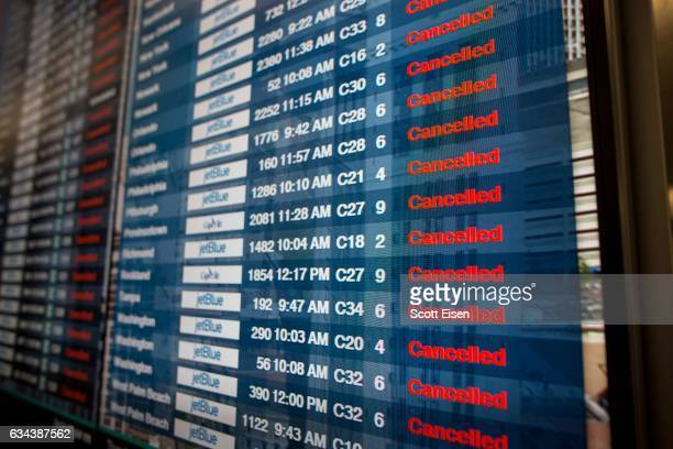 Cancelled flights are listed on a screen at Logan International Airport as winter storm conditions begin during the early morning on February 9 2017...