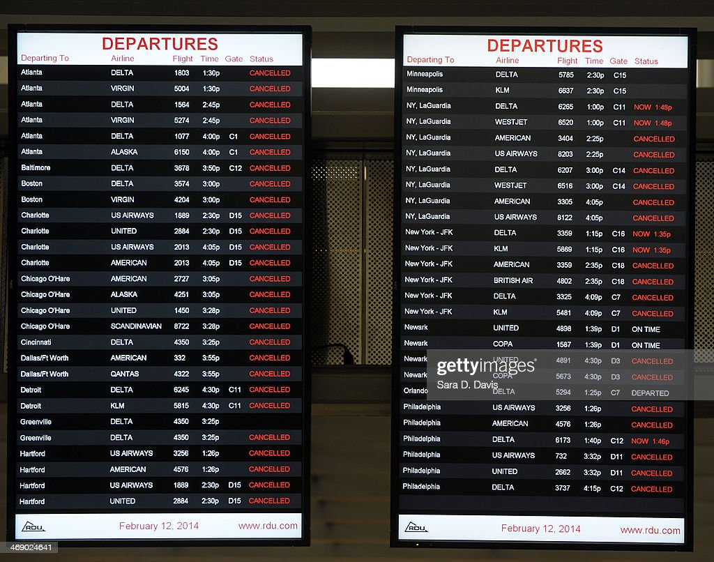 Cancelled flights are shown at the Raleigh-Durham International Airport on February 12, 2014 in Morrisville, North Carolina. Over 100 flights were canceled by 2pm bacause of the winter storm hitting the area.