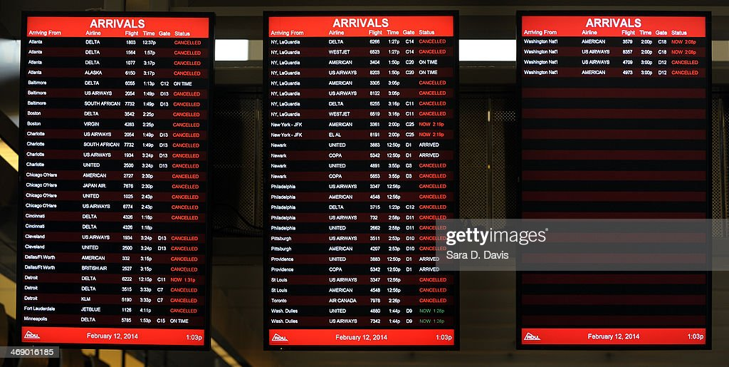 Cancelled incoming flights are shown at the Raleigh-Durham International Airport on February 12, 2014 in Morrisville, North Carolina. Over 100 flights were canceled by 2pm bacause of the winter storm hitting the area.