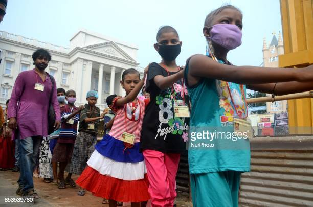 Cancer affected Indian children visits the Durga puja pandal or temporary platforms during the Durga Puja festival in Kolkata India on Monday 25th...