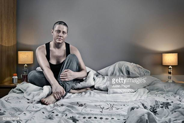 Cancer Patient Sitting on Bed