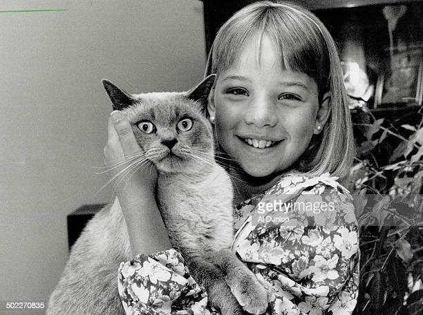 Cancer recovery Tara Mckinnon 10 of Aurora shown yesterday with her cat Ming wants other children to know leukemia can be beaten