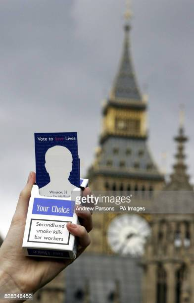 Cancer Research hand out fake cigarette packets to MPs Monday February 13 with the health warning 'Secondhand smoke kills bar workers' Health...