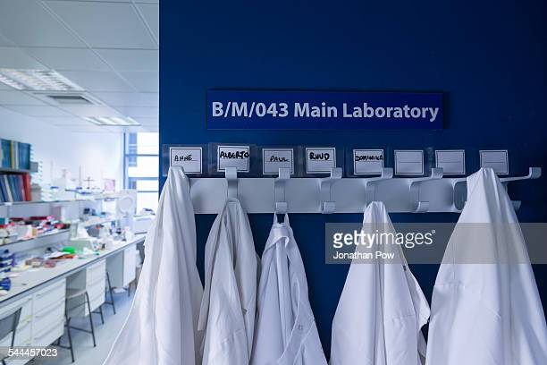 Cancer research laboratory, row of lab coats