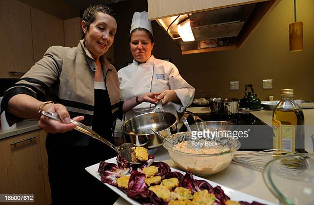 Cancer survivor Jennifer Prober gets cooking tips from Sharon Booy in the kitchen of the new wellness centre for survivors at Toronto General...