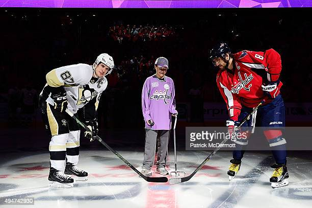 Cancer survivor Sam Becker takes part in a ceremonial puck drop with Sidney Crosby of the Pittsburgh Penguins and Alex Ovechkin of the Washington...