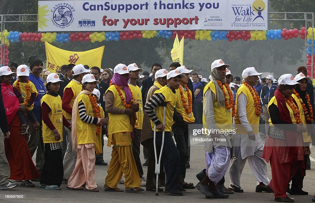 "Cancer Survivors and Peoples participating ""walk for life"" for support of world Cancer day at Rajpath on February 3, 2013 in New Delhi, India. A Colorful event that saw school children prominent citizens and peoples from all Sections of Society gather to express their solidarity with hose living with cancer and to mark world cancer day."