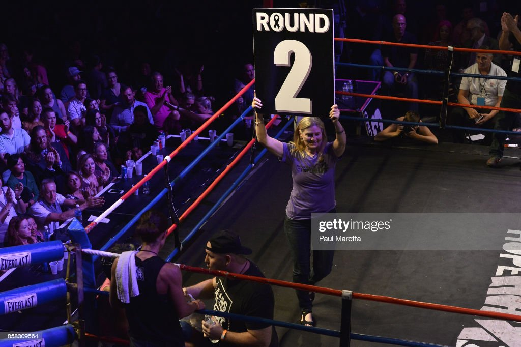 Cancer survivors mark the rounds at the Haymakers for Hope Fundraiser - 2017 Belles of the Brawl at House of Blues Boston on October 5, 2017 in Boston, Massachusetts. Organizers estimate app. $450,000 was raised with this single event in Boston nd more than $7.5m since its inception. Amature boxers train for four months with professional trainers and step into the ring to fight a professionally organized boxing match to raise money and awareness for cancer research.