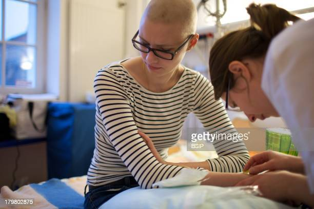 Cancerous Adolescent In Hospital This photo essay can be used only to illustrate cancer Raymond Poincare Hospital Department of pediatric oncology...