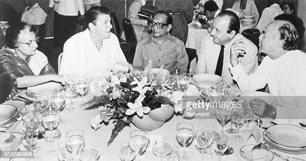 United States President Ronald Reagan talks with heads of state during a dinner hosted by Mexico President Lopez Portillo Also pictured Prime...