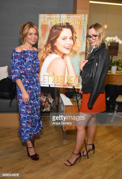 Candace Cameron and Natasha Bure attend the Natasha Bure 'Let's Be Real' Los Angeles book launch party at Eden By Eden Sassoon on March 24 2017 in...