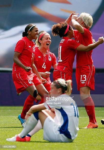 Candace Chapman Carmelina Moscato Desiree Scott and Sophie Schmidt of Canada celebrate after defeating Camille Abily of France to win the women's...