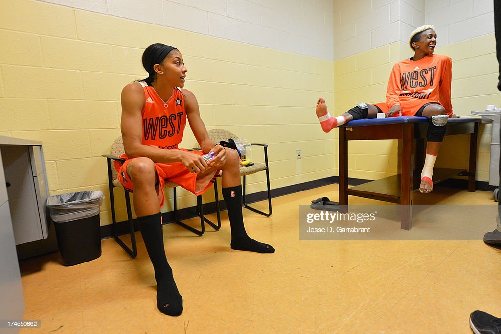 Candace Parker and Danielle Robinson of the Western Conference All-Stars wait in the training room before the 2013 Boost Mobile WNBA All-Star Game on July 27, 2013 at Mohegan Sun Arena in Uncasville, Connecticut.