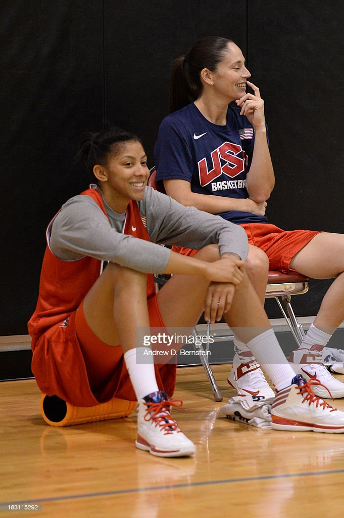 Candace Parker #15 and Diana Taurasi #12 sit on the sideline during the USA Womens National Team Mini-Camp on October 4, 2013 at the Cox Pavilion in Las Vegas, Nevada.