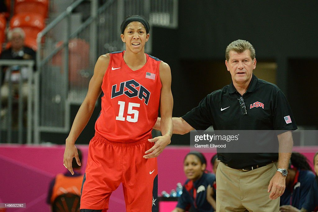 Candace Parker and Geno Auriemma of the United States look on against Angola at the Olympic Park Basketball Arena during the London Olympic Games on...