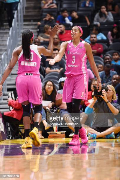 Candace Parker and Nneka Ogwumike of the Los Angeles Sparks shake hands during the game against the San Antonio Stars on August 22 2017 at the...