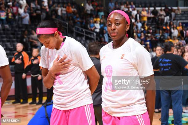 Candace Parker and Nneka Ogwumike of the Los Angeles Sparks stand for the National Anthem before the game against the San Antonio Stars on August 22...