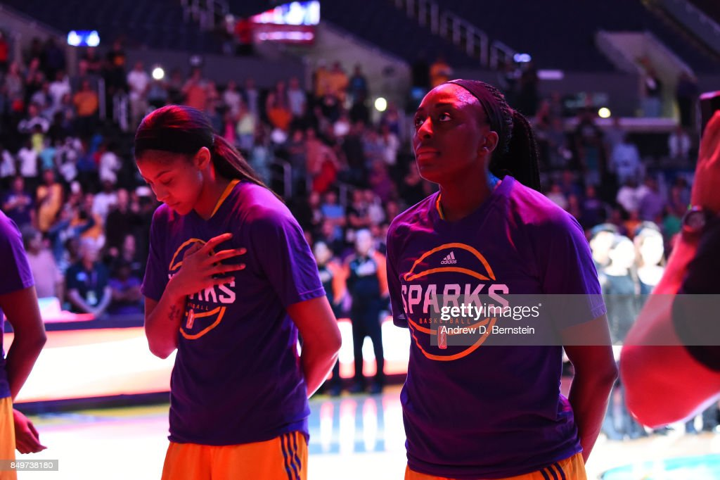 Candace Parker #3 and Nneka Ogwumike #30 of the Los Angeles Sparks stand for the National Anthem before the game against the Phoenix Mercury in Game One of the Semifinals during the 2017 WNBA Playoffs on September 12, 2017 at STAPLES Center in Los Angeles, California.