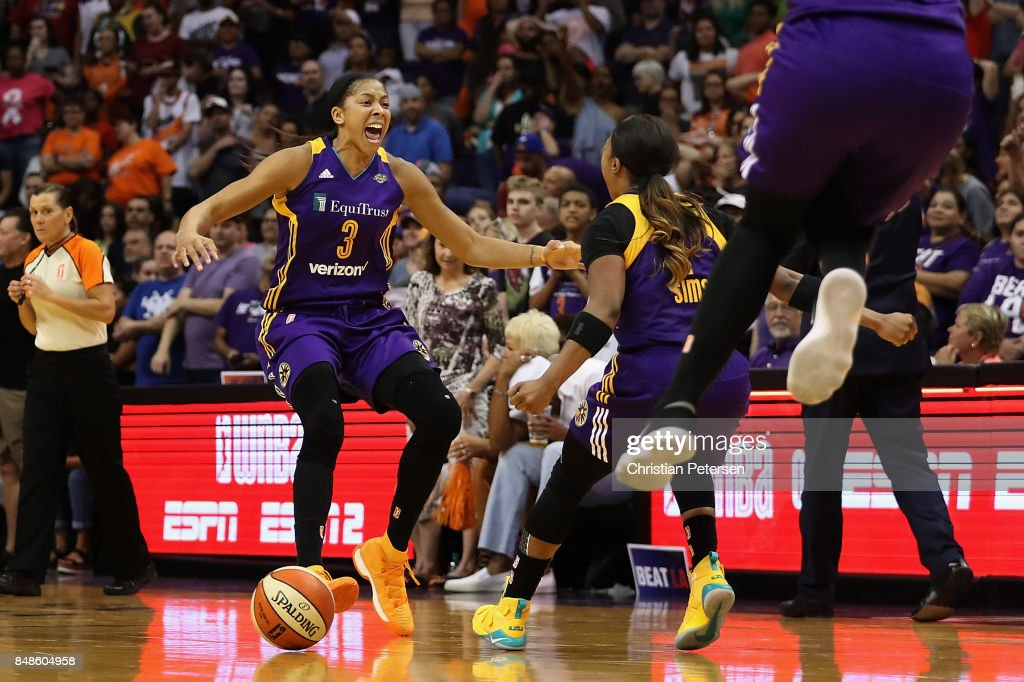 Candace Parker #3 and Odyssey Sims #1 of the Los Angeles Sparks celebrate after defeating the Phoenix Mercury in the semifinal game three of the 2017 WNBA Playoffs at Talking Stick Resort Arena on September 17, 2017 in Phoenix, Arizona. The Sparks defeated the Mercury 89-87.