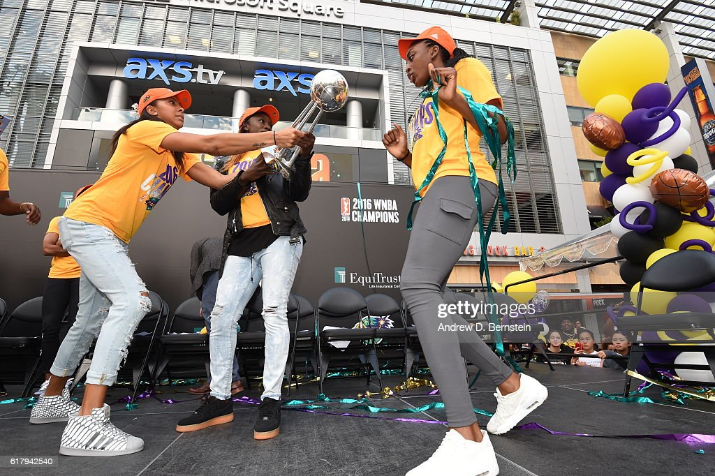 Candace Parker #3, Essence Carson #17 and Nneka Ogwumike #30 of the Los Angeles Sparks smile and dance on stage during the Championship Rally at L.A. LIVE on October 24, 2016 in Los Angeles, California.