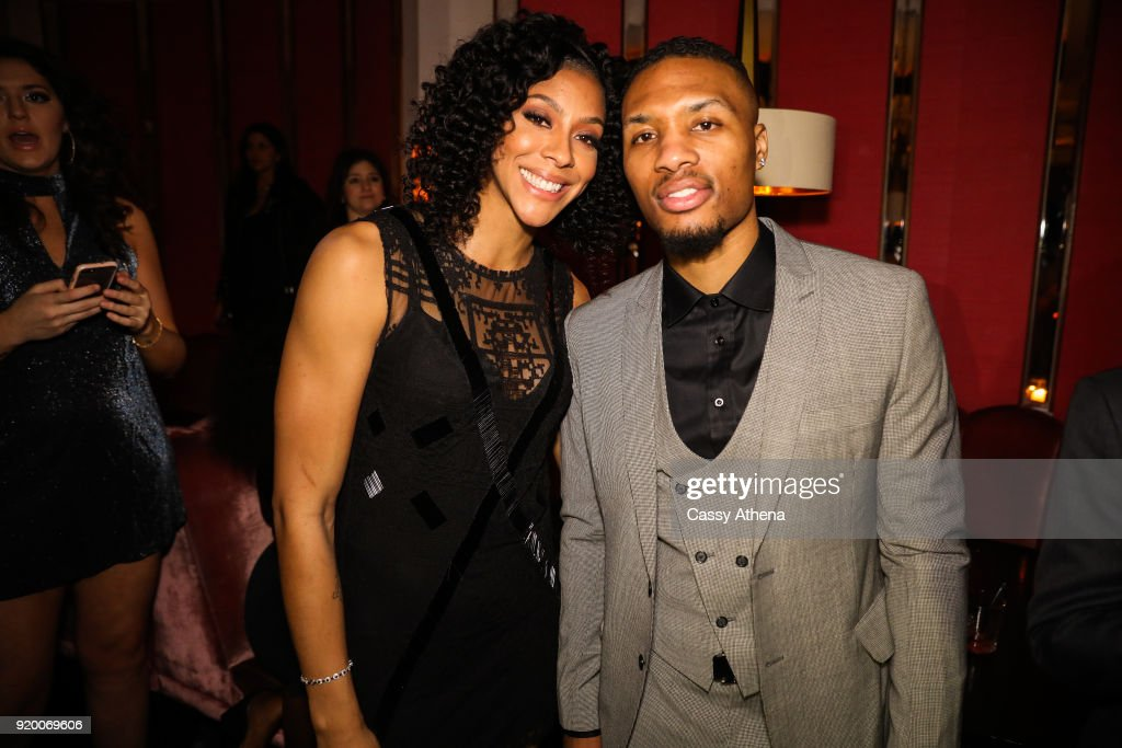 Candace Parker (L) of the Los Angeles Sparks and Damian Lillard (R) of the Portland Trailblazers pose at the Adidas hosts All Star Black Tie on February 15, 2018 in Los Angeles, California.