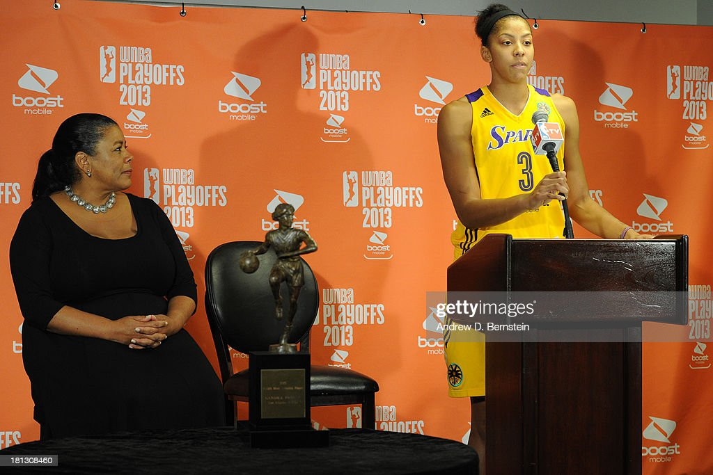 Candace Parker #3 of the Los Angeles Sparks and Laurel Pitchie the WNBA Commissioner pose for a picture during a press conference for being awarded the WNBA's Most Valuable Player for the 2013 season at STAPLES Center on September 19, 2013 in Los Angeles, California.