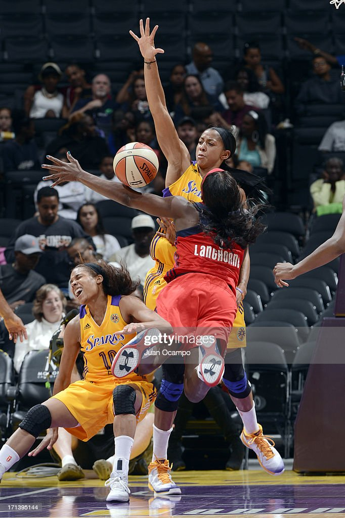 Candace Parker #3 of the Los Angeles Sparks battles for the ball control against Crystal Langhorne #1 of the Washington Mystics during the game at Staples Center on June 23, 2013 in Los Angeles, California.