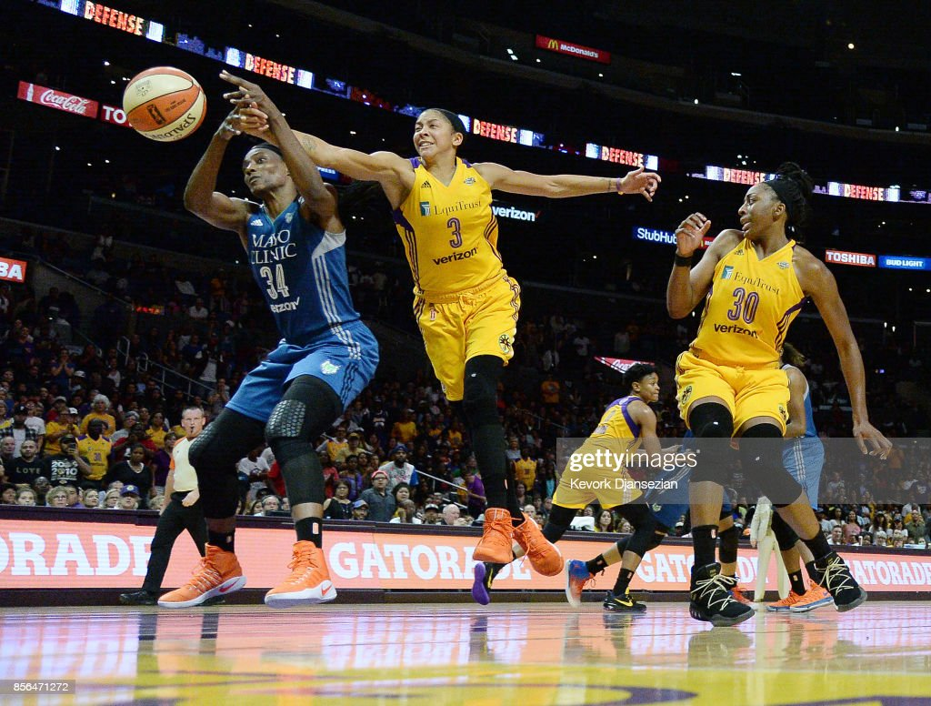 Candace Parker #3 of the Los Angeles Sparks battles for the ball with Sylvia Fowles #34 of the Minnesota Lynx while teammate Nneka Ogwumike #30 of the Los Angeles Sparks during the second half of Game Four of WNBA Finals at Staples Center October 1, 2017, in Los Angeles, California.