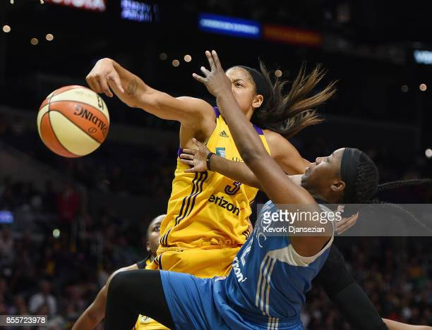 Candace Parker of the Los Angeles Sparks blocks a layup by Alexis Jones of the Minnesota Lynx during the second half of Game Three of WNBA Finals at...