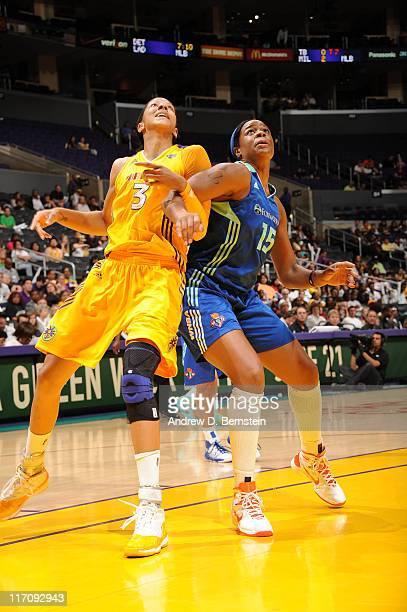 Candace Parker of the Los Angeles Sparks boxes out against Kia Vaughn of the New York Liberty at Staples Center on June 21 2011 in Los Angeles...