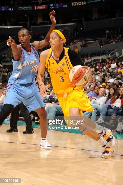 Candace Parker of the Los Angeles Sparks drives to the basket against Sancho Lyttle of the Atlanta Dream during the WNBA game at Staples Center on...