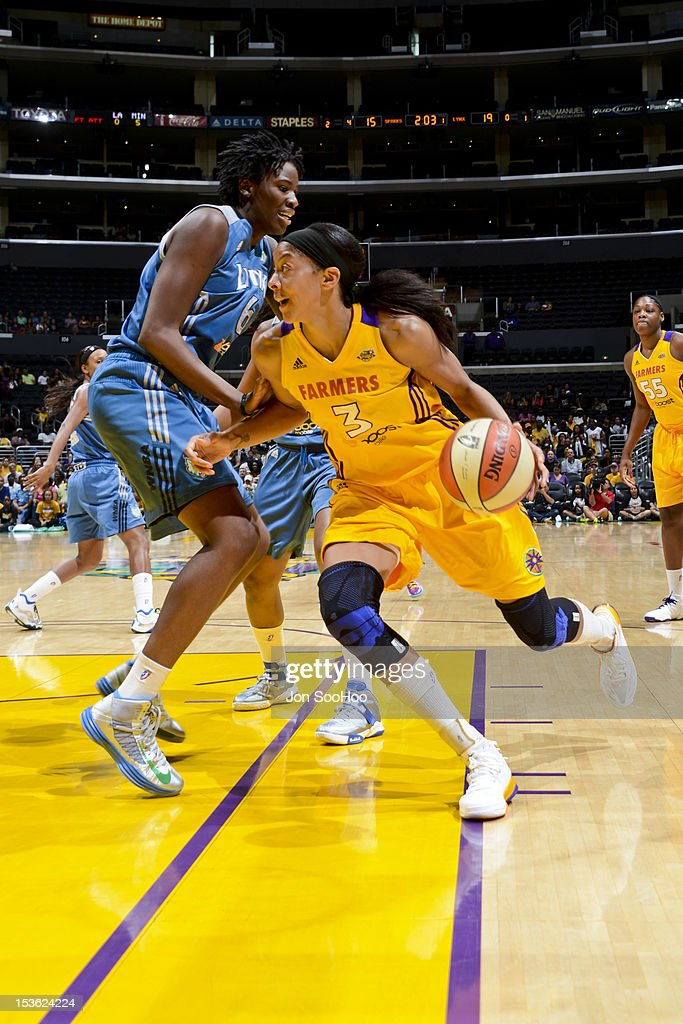Candace Parker #3 of the Los Angeles Sparks drives to the basket against Amber Harris #6 of the Minnesota Lynx during Game Two of the WNBA Western Conference Finals at Staples Center on October 7, 2012 in Los Angeles, California.