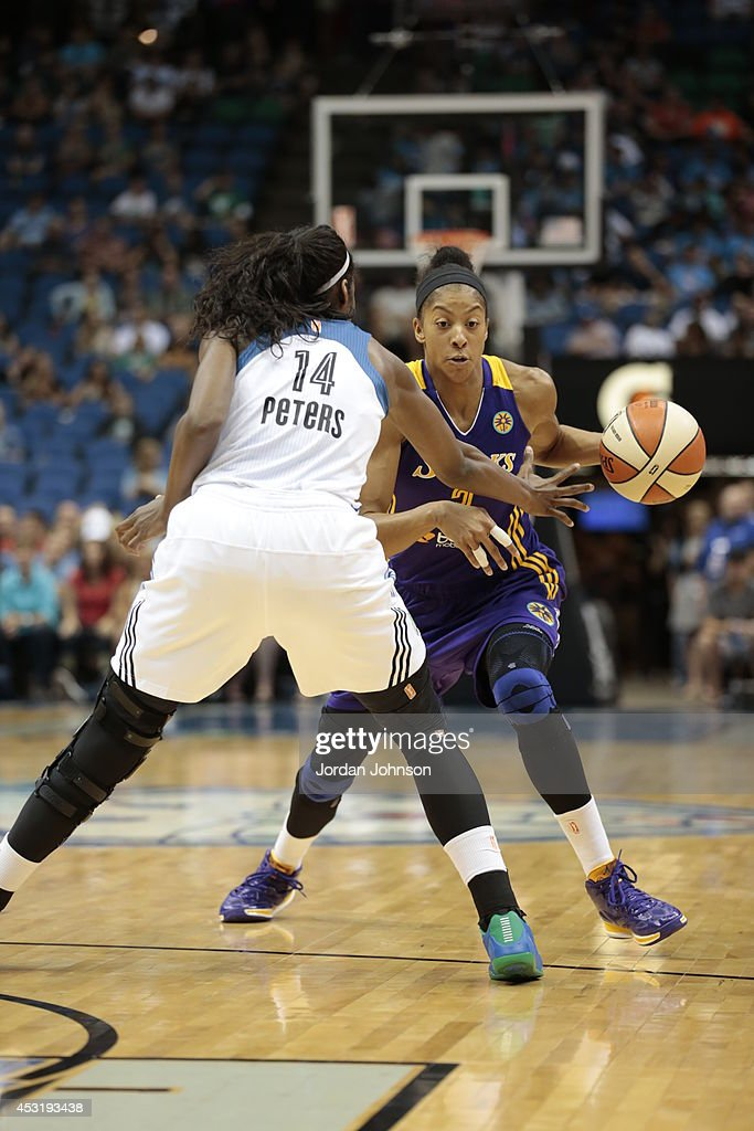 Candace Parker #3 of the Los Angeles Sparks drives to the basket against Devereaux Peters #14 of the Minnesota Lynx during the WNBA game on July 8, 2014 at Target Center in Minneapolis, Minnesota.
