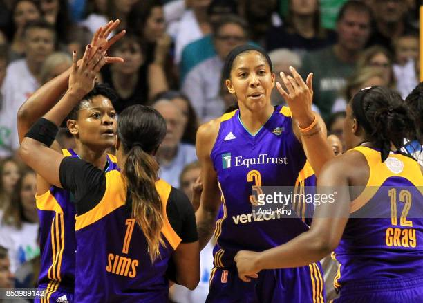 Candace Parker of the Los Angeles Sparks gathers teammates Odyssey Sims Alana Beard and Chelsea Gray against the Minnesota Lynx during the second...