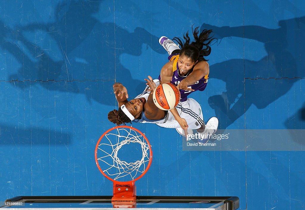Candace Parker of the Los Angeles Sparks goes against Rebekkah Brunson of the Minnesota Lynx during the game on August 20 2011 at Target Center in...