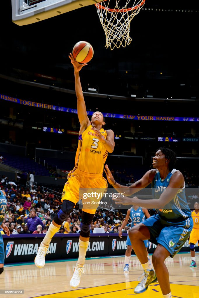 Candace Parker #3 of the Los Angeles Sparks goes to the basket against Amber Harris #6 of the Minnesota Lynx during Game Two of the WNBA Western Conference Finals at Staples Center on October 7, 2012 in Los Angeles, California.