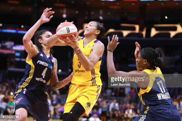 Candace Parker of the Los Angeles Sparks handles the ball against Candice Dupree and Erica Wheeler of the Indiana Fever during a WNBA basketball game...