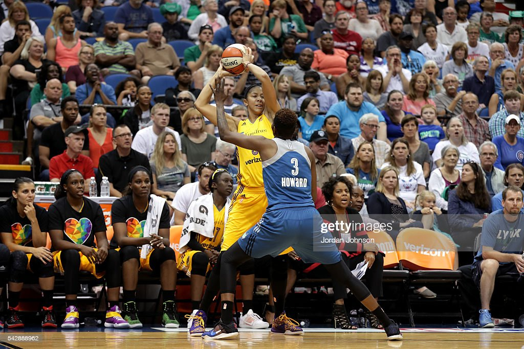 <a gi-track='captionPersonalityLinkClicked' href=/galleries/search?phrase=Candace+Parker&family=editorial&specificpeople=752955 ng-click='$event.stopPropagation()'>Candace Parker</a> #3 of the Los Angeles Sparks handles the ball during the game against <a gi-track='captionPersonalityLinkClicked' href=/galleries/search?phrase=Natasha+Howard+-+Basketball+Player&family=editorial&specificpeople=12732198 ng-click='$event.stopPropagation()'>Natasha Howard</a> #3 of the Minnesota Lynx during the WNBA game on June 24, 2016 at Target Center in Minneapolis, Minnesota.